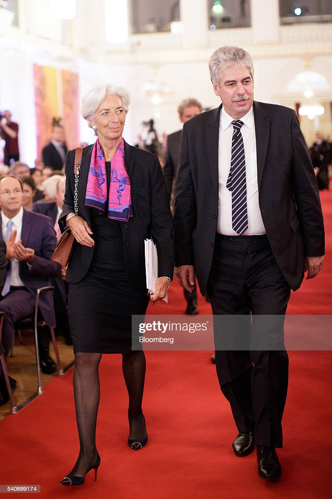 Christine Lagarde managing director of the International Monetary Fund left and Hans Joerg Schelling Austria's finance minister arrive for a panel...