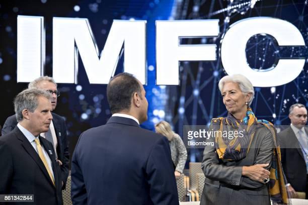Christine Lagarde managing director of the International Monetary Fund right and David Lipton first deputy managing director of the IMF left speak...