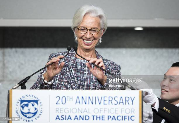 Christine Lagarde managing director of the International Monetary Fund adjusts microphones before a speech during an event marking the 20th...