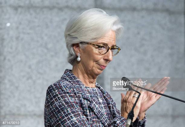 Christine Lagarde managing director of the International Monetary Fund claps after delivering a speech during an event marking the 20th anniversary...