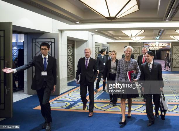 Christine Lagarde managing director of the International Monetary Fund center right and Masatsugu Asakawa vice minister for international affairs at...