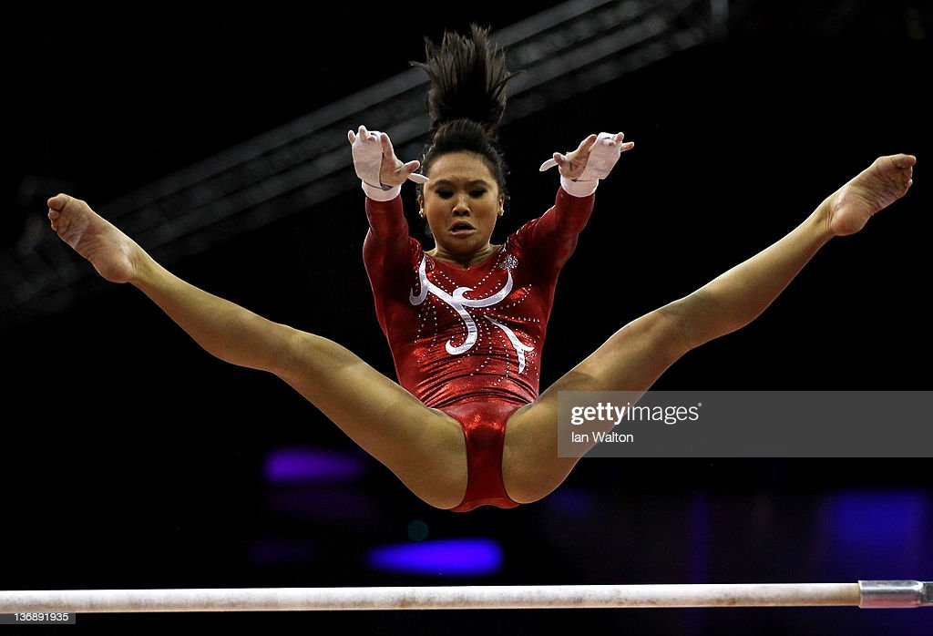 Christine Lee of Canada in action on the parallel Bars during the 3rd day of the Men's Gymnastics Final at North Greenwich Arena on January 12, 2012 in London, England.