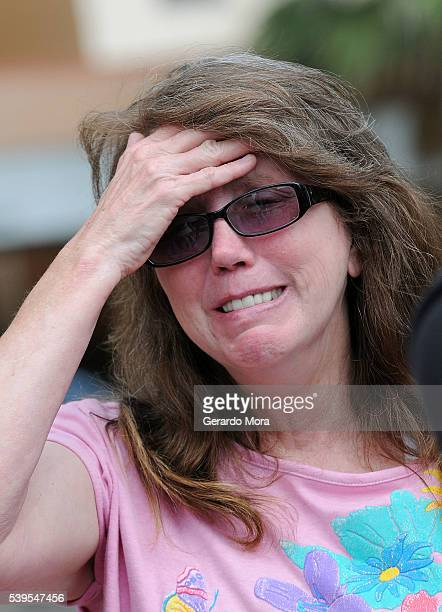 Christine Leinonen waits for information outside of the Orlando Regional Medical Center about her son Chris who is missing after a fatal shooting and...