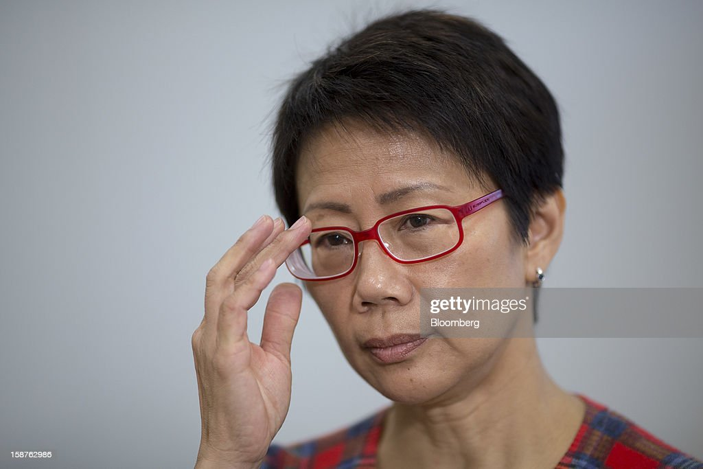 Christine Loh, Hong Kong's undersecretary for environment, adjusts her spectacles during an interview in Hong Kong, China, on Monday, Dec. 17, 2012. Hong Kong will ban high-polluting vehicles and offer subsidies to replace diesel-powered buses and trucks, after 15 years of clean-air measures failed to limit smog responsible for more than 3,000 premature deaths a year. Photographer: Jerome Favre/Bloomberg via Getty Images