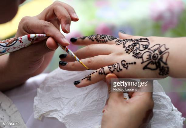 TORONTO ON JULY 23 Christine Loveday gets henna put on her hand Thousands came out to the Festival of South Asia this past weekend on Gerrard St East...