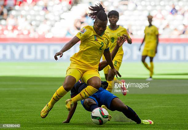 Christine Manie of Cameroon jumps to avoid the tackle of Monica Quinteros of Ecuador during the FIFA Women's World Cup Canada 2015 Group C match...
