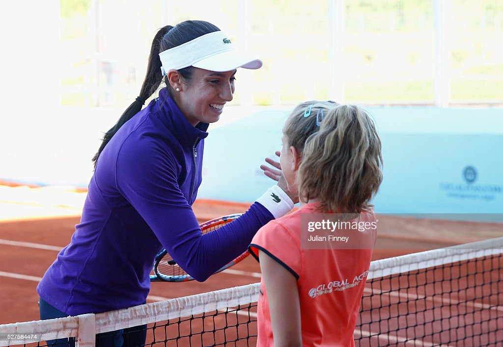 Christine McHale of USA meets and plays with a young tennis player during day four of the Mutua Madrid Open tennis tournament at the Caja Magica on May 03, 2016 in Madrid, Spain.
