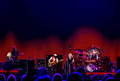 Christine McVie John McVie Stevie Nicks and Mick Fleetwood of Fleetwood Mac perform during the On With the Show Tour 2014 at The Palace of Auburn...
