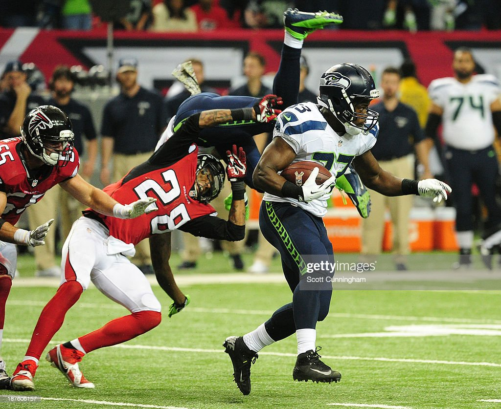 <a gi-track='captionPersonalityLinkClicked' href=/galleries/search?phrase=Christine+Michael&family=editorial&specificpeople=6235349 ng-click='$event.stopPropagation()'>Christine Michael</a> #33 of the Seattle Seahawks carries the ball against the Atlanta Falcons at the Georgia Dome on November 10, 2013 in Atlanta, Georgia.