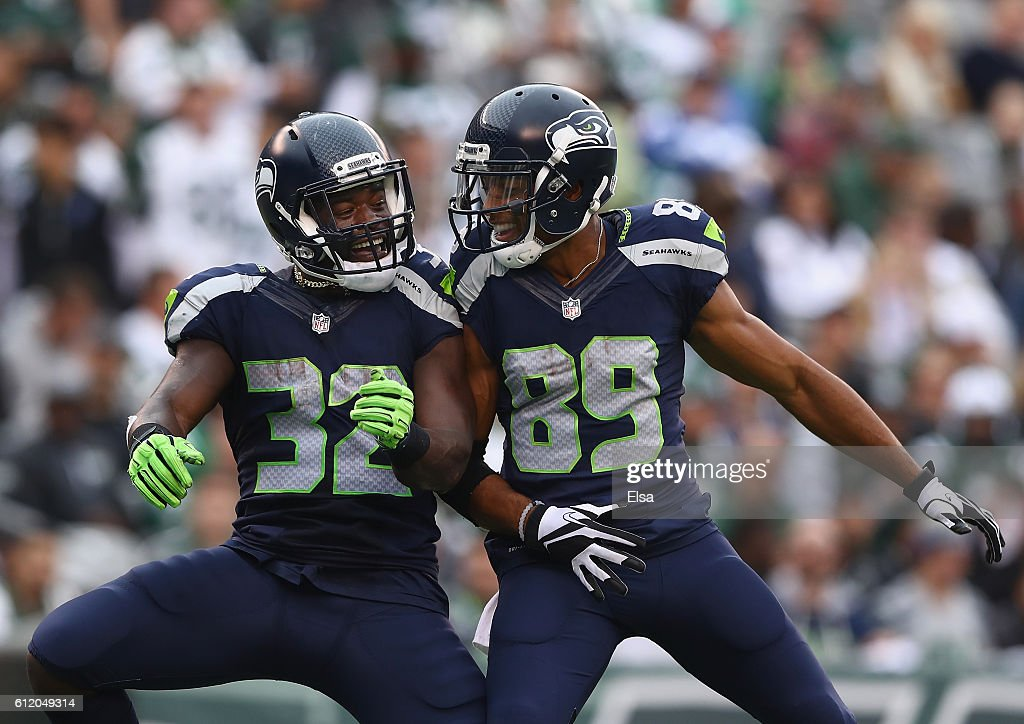 Christine Michael #32 of the Seattle Seahawks celebrates his fourth quarter touchdown with teammate Doug Baldwin #89 against the New York Jets at MetLife Stadium on October 2, 2016 in East Rutherford, New Jersey.