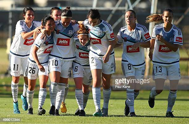 Christine Nairn of the Victory celebrates a goal with team mates during the round seven ALeague match between Perth Glory and Melbourne Victory at...