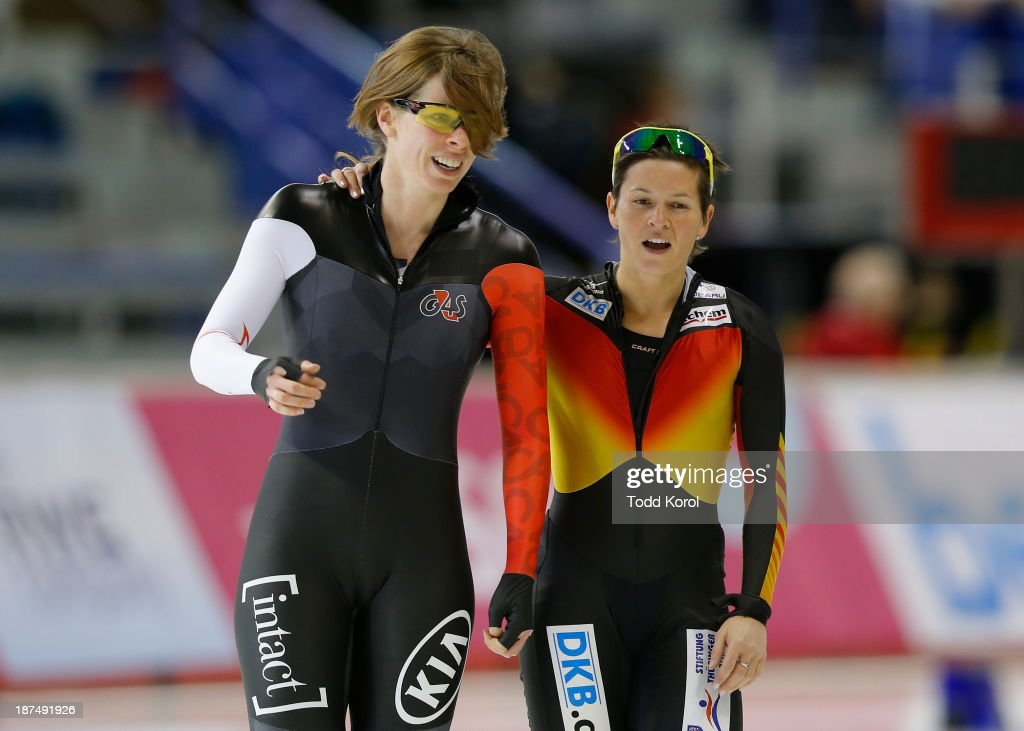 <a gi-track='captionPersonalityLinkClicked' href=/galleries/search?phrase=Christine+Nesbitt&family=editorial&specificpeople=767742 ng-click='$event.stopPropagation()'>Christine Nesbitt</a> of Canada (L) is hugged by <a gi-track='captionPersonalityLinkClicked' href=/galleries/search?phrase=Judith+Hesse&family=editorial&specificpeople=816790 ng-click='$event.stopPropagation()'>Judith Hesse</a> of Germany ofter their race in the women's 500 meter race during the ISU World Cup Speed Skating event November 9, 2013 in Calgary, Alberta, Canada.