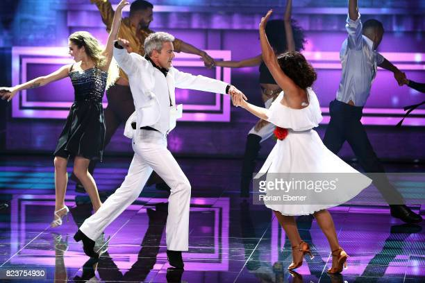 Christine Neubauer and Gedeon Burkhard perform on stage during the 1st show of the television competition 'Dance Dance Dance' on July 12 2017 in...