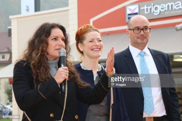Christine Neubauer Enie van de Meiklokjes Frank Dehmer attend the opening of the City Outlet Geislingen on October 27 2016 in Geislingen Germany