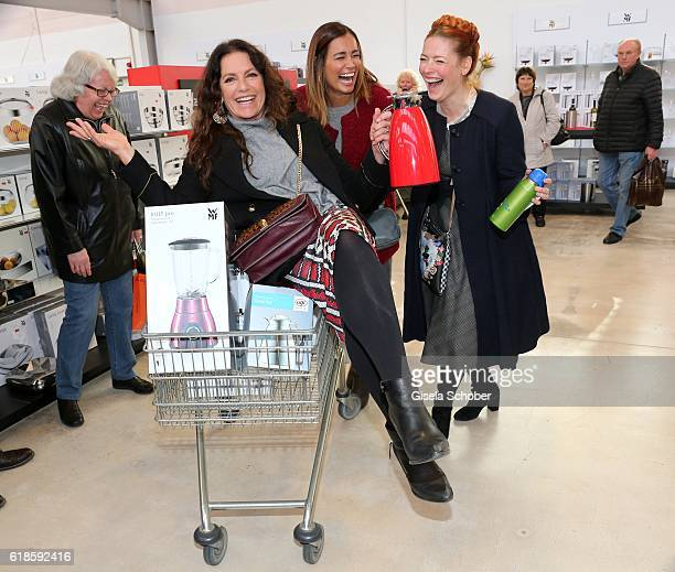 Christine Neubauer Jana Ina Zarella and Enie van de Meiklokjes during the opening of the City Outlet Geislingen on October 27 2016 in Geislingen...