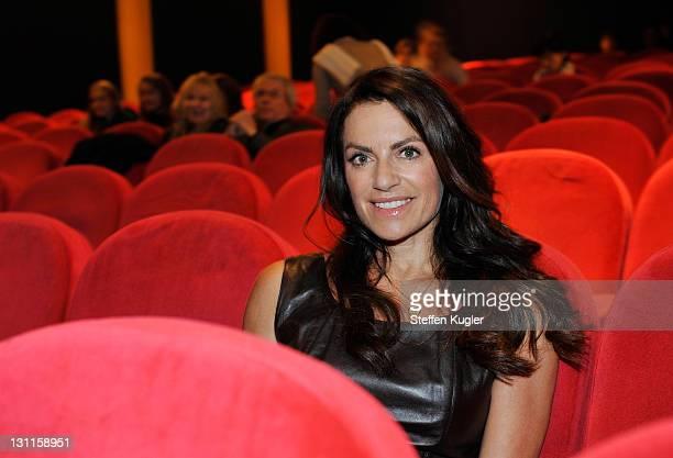 Christine Neubauer sits in the red chairs of Kino Filmkunst66 prior to viewing her new movie 'Das Maedchen aus dem Regenwald' at Kino Filmkunst66 on...