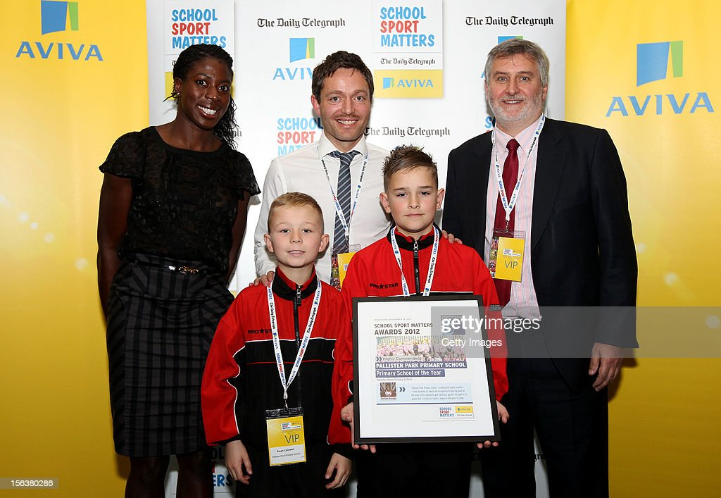 <a gi-track='captionPersonalityLinkClicked' href=/galleries/search?phrase=Christine+Ohuruogu&family=editorial&specificpeople=703549 ng-click='$event.stopPropagation()'>Christine Ohuruogu</a> (L) and Clive Efford MP (R) pose with Primary School of the Year highly commended nominee Pallister Park Primary School during the AVIVA and Daily Telegraph School Sport Matters awards at Lord's Cricket Ground on November 14, 2012 in London, England.