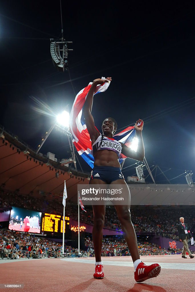 Christine Ohuruogu of Great Britain celebrates winning dilver in the Women's 400m Final on Day 9 of the London 2012 Olympic Games at the Olympic...