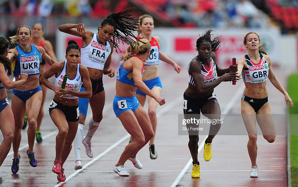 <a gi-track='captionPersonalityLinkClicked' href=/galleries/search?phrase=Christine+Ohuruogu&family=editorial&specificpeople=703549 ng-click='$event.stopPropagation()'>Christine Ohuruogu</a> of Great Britain (R) takes the baton for the last leg of the Womens 4 X400 metres during day two of the European Athletics Team Championships at Gateshead International Stadium on June 23, 2013 in Gateshead, England.