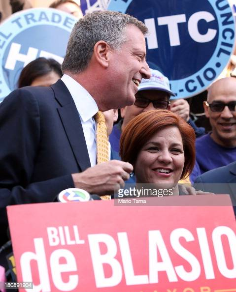 Christine Quinn New York City Council Speaker and former mayoral hopeful smiles with Democratic Party nominee Bill de Blasio at a news conference...