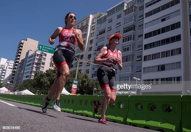 Christine Robbins from Canada and guide Sasha Boulton during Triathlon Women's PT5 at Forte de Copacabana on day 4 of the Rio 2016 Paralympic Games...