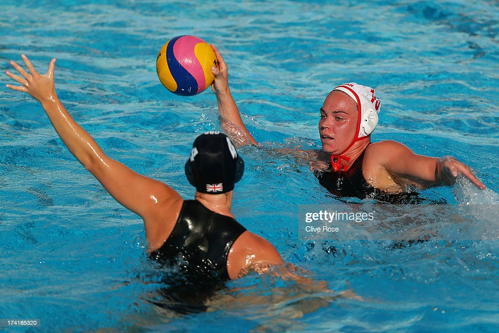 Christine Robinson of Canada looks to pass the ball under pressure from Ciara Gibson-Bryne of Great Britain during the Women's Water Polo first preliminary round match between Canada and Great Britain during Day Two of the 15th FINA World Championships at Piscines Bernat Picornell on July 21, 2013 in Barcelona, Spain.