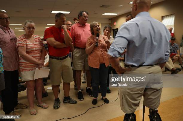 Christine Schwartz asks a question to Rep Brian Mast during a town hall meeting at the Havert L Fenn Center on February 24 2017 in Fort Pierce...
