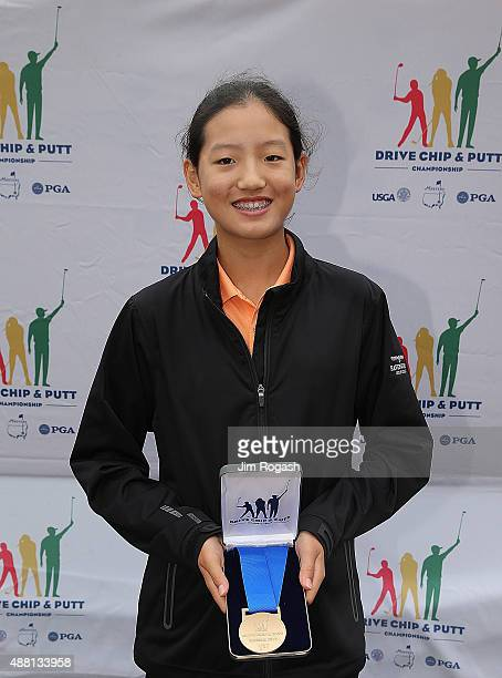 Christine Shao first place winner in the Girls 1415 putting competition poses with her medal during the 2015 Drive Chip and Putt Championship at The...