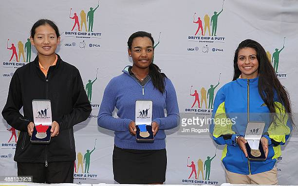 Christine Shao second place winner Kyra Cox first place winner and Kristina Thimme third place winner in the Girls 1415 Driving Competition pose with...