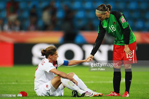 Christine Sinclair and Erin McLeod of Canada is seen after the FIFA Women's World Cup 2011 Group A match between Canada and France at Rewirpower...
