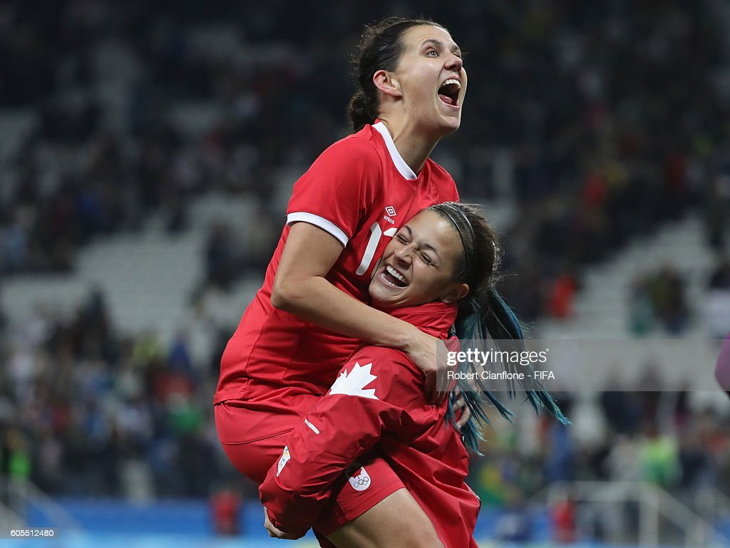Christine Sinclair and Sabrina D'Angelo of Canada celebrate after canada defeated France during the Women's Football Quarter Final match between Canada and France on Day 7 of the Rio 2016 Olympic Games at Arena Corinthians on August 12, 2016 in Sao Paulo, Brazil.