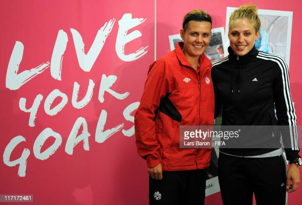 Christine Sinclair of Canada and Kim Kulig of Germany pose after the 2011 FIFA Womens Football Live Your Goals Campaign press conference at Olympia...