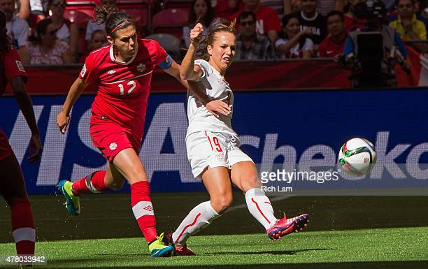 Christine Sinclair of Canada battles with Lia Walti of Switzerland for the ball during the FIFA Women's World Cup Canada 2015 Round of 16 match...