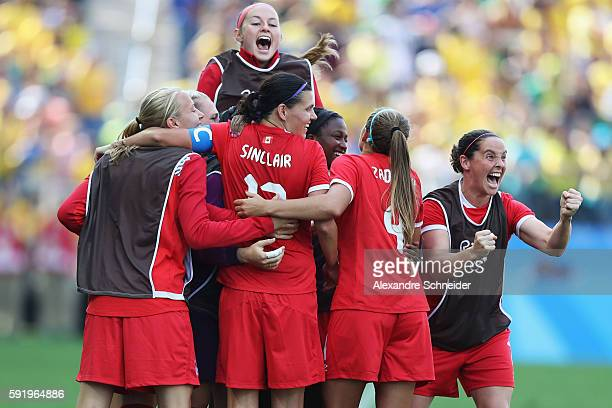 Christine Sinclair of Canada celebrates after scoing her sides second goal during the Women's Olympic Football Bronze Medal match between Brazil and...