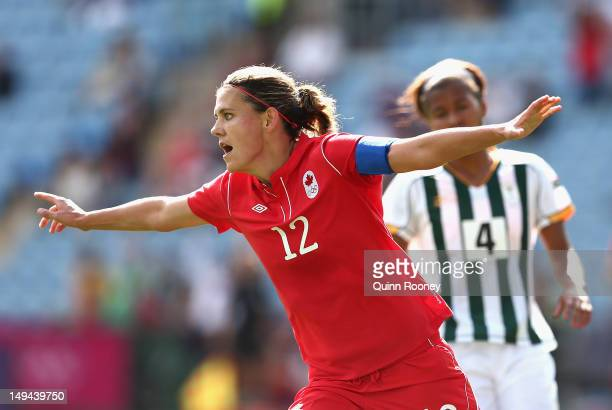 Christine Sinclair of Canada celebrates scoring a goal during the Women's Football first round Group F Match of the London 2012 Olympic Games between...