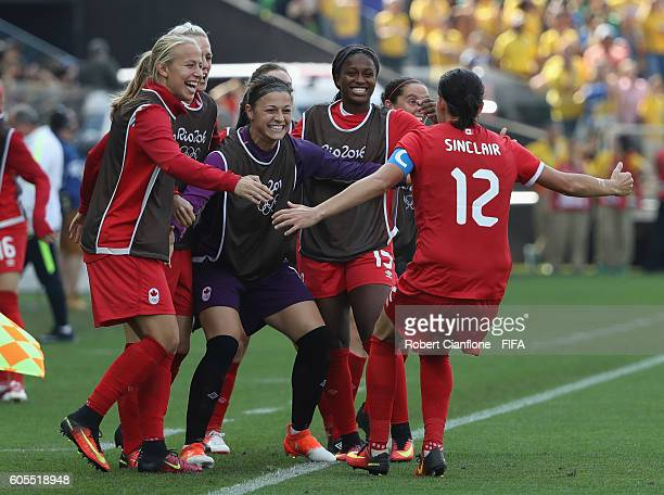 Christine Sinclair of Canada celebrates with team mates after scoring a goal during the Women's Football Bronze Medal match between Brazil and Canada...