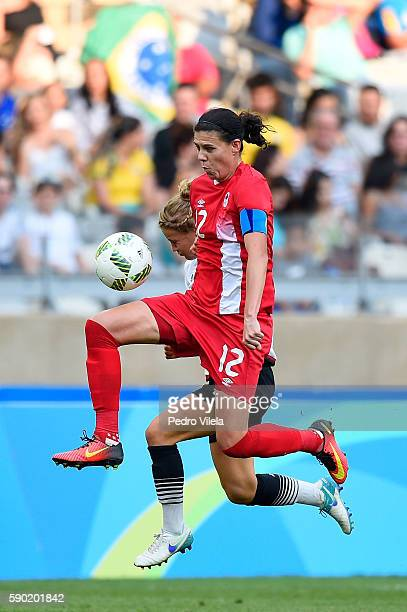 Christine Sinclair of Canada competes for the ball during the Women's Semi Final match between Germany and Canada on Day 11 of the Rio 2016 Olympic...