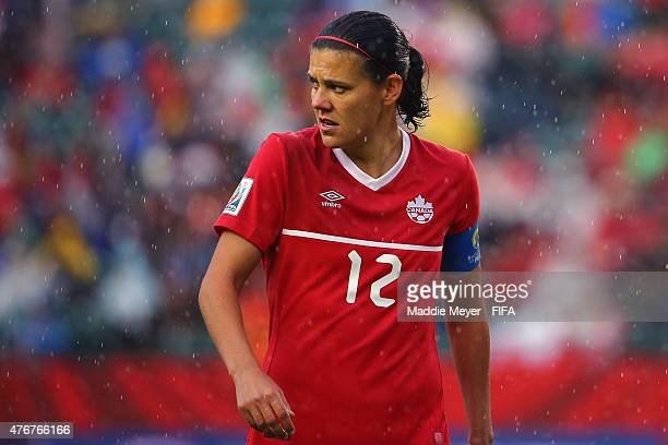 Christine Sinclair of Canada exits the field during a rain delay during the FIFA Women's World Cup Canada 2015 Group A match against the New Zealand...