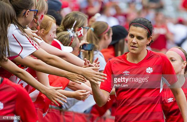Christine Sinclair of Canada high fives fans after the team warmup prior to the start of the FIFA Women's World Cup Canada 2015 Round of 16 match...