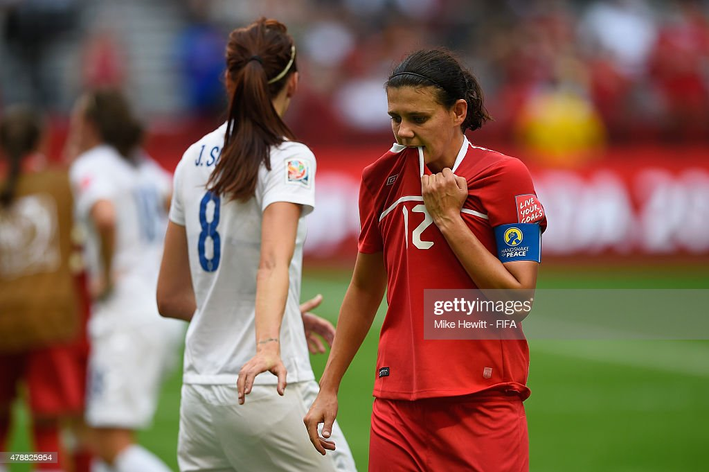Christine Sinclair of Canada is consoled by Jill Scott of England after the FIFA Women's World Cup 2015 Quarter Final match between England and Canada at BC Place Stadium on June 27, 2015 in Vancouver, Canada.