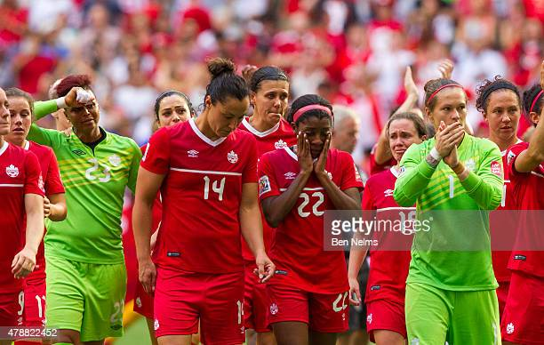 Christine Sinclair of Canada is pictured with teammates after losing to England during the FIFA Women's World Cup Canada 2015 Quarter Final match...