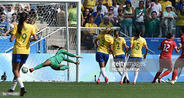 TOPSHOT Christine Sinclair of Canada kicks the ball to score against Brazil during the Rio 2016 Olympic Games women's bronze medal football match...