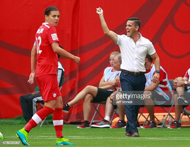Christine Sinclair of Canada looks on as Canada coach John Herdman yells during the FIFA Women's World Cup Canada 2015 Round 16 match between...