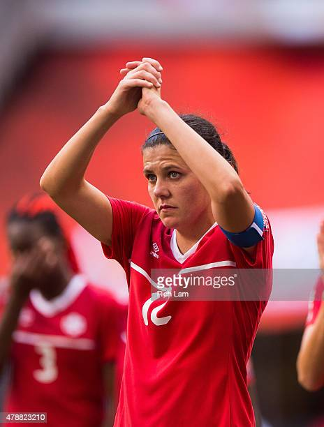 Christine Sinclair of Canada salutes the crowd after losing to England 21 in the FIFA Women's World Cup Canada 2015 Quarter Final match between the...