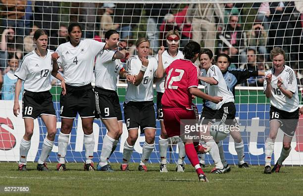 Christine Sinclair of Canada shoots a freekick during the nations match between Germany and Canada at the FriedrichEbertStadion on April 24 2005 in...