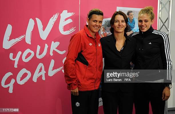 Christine Sinclair of Canada Tatjana Haenni head of women's football FIFA and Kim Kulig of Germany pose after the 2011 FIFA Womens Football Live Your...