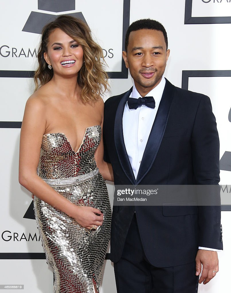 Christine Teigen (L) and John Legend (R) arrive at the 56th Annual GRAMMY Awards at Staples Center on January 26, 2014 in Los Angeles, California.