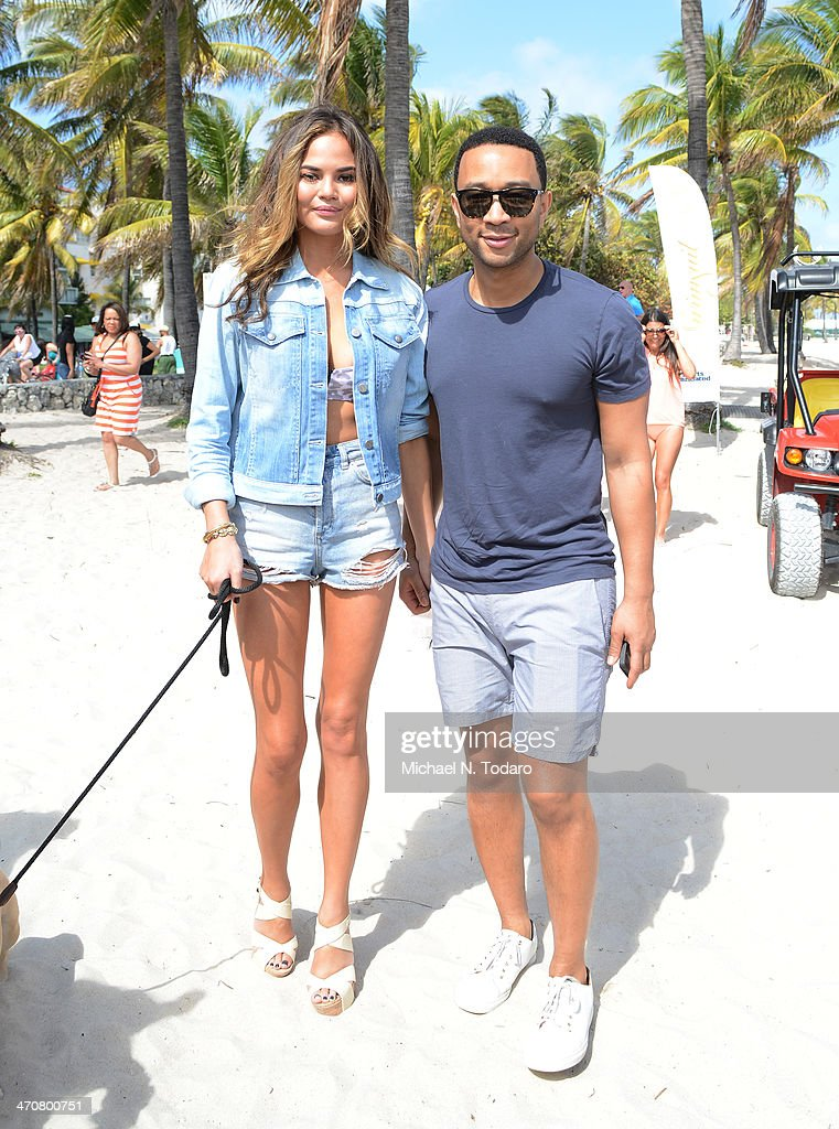 <a gi-track='captionPersonalityLinkClicked' href=/galleries/search?phrase=Christine+Teigen&family=editorial&specificpeople=4583768 ng-click='$event.stopPropagation()'>Christine Teigen</a> and <a gi-track='captionPersonalityLinkClicked' href=/galleries/search?phrase=John+Legend&family=editorial&specificpeople=201468 ng-click='$event.stopPropagation()'>John Legend</a> attend Chefs + Models Volleyball Tournament during the Food Network South Beach Wine & Food Festival on February 20, 2014 in Miami, Florida.