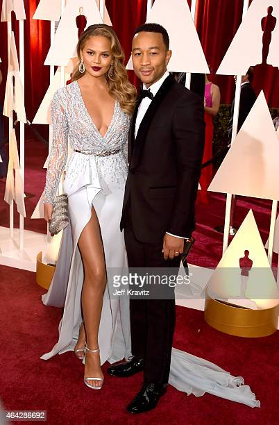Christine Teigen and John Legend attend the 87th Annual Academy Awards at Hollywood Highland Center on February 22 2015 in Hollywood California