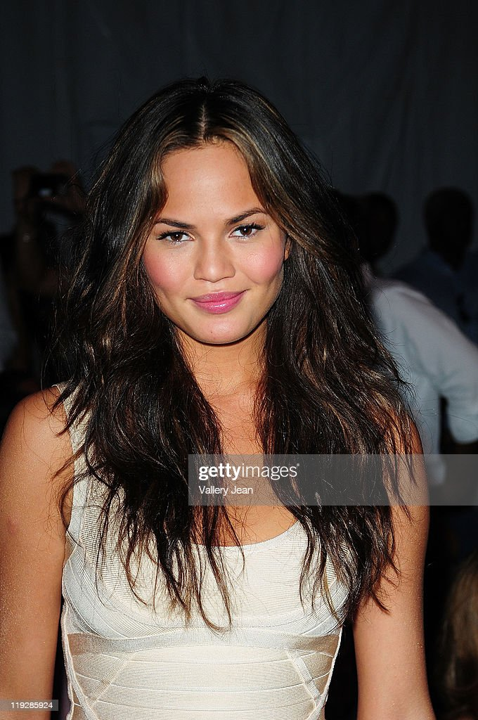 Christine Teigen attends the Beach Bunny Swimwear show during Mercedes-Benz Fashion Week Swim 2012 at Raleigh Hotel on July 15, 2011 in Miami Beach, Florida.